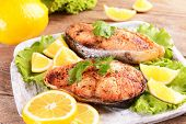 Tasty baked fish on plate on table close-up