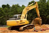 foto of backhoe  - Backhoe machine uses shovel scooper to excavate and move dirt - JPG