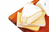image of brie cheese  - solid french cheese parmesan brie and edam on wooden platter isolated on white background - JPG
