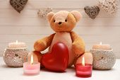 Teddy bear with candles, love concept