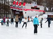 People Relaxing At The Skating Rink