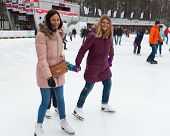 Girls Skating And Smiling At Park