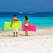 image of raft  - Couple with inflatable rafts on a tropical beach at Maldives - JPG