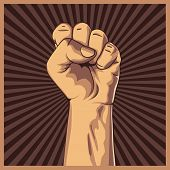 picture of clenched fist  - Clenched fist held high in protest background - JPG