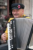 Jerusalem, Israel - March 15, 2006: Purim Carnival, Street Musician Plays The Accordion.