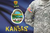 image of kansas  - American soldier with US state flag on background  - JPG