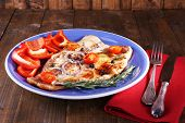 foto of pangasius  - Dish of Pangasius fillet with spices and vegetables on wooden table background - JPG