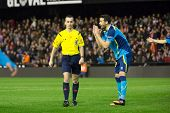 VALENCIA, SPAIN - JANUARY 25: Iborra (R) and referee Jaime Latre during Spanish League match between Valencia CF and Sevilla FC at Mestalla Stadium on January 25, 2015 in Valencia, Spain