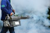 picture of malaria parasite  - Man Fogging to prevent spread of dengue fever in thailand - JPG