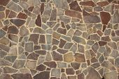 pic of mortar-joint  - Natural stone wall made of different brown stones - JPG