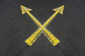 Two Crossed Yellow Arrows