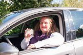 pic of driving  - Young woman has passed the driving test drive a car - JPG