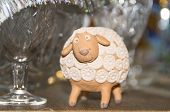 Clay figurine of lamb on festive table
