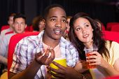 picture of cinema auditorium  - Young couple watching a film at the cinema - JPG