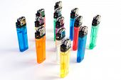 picture of cigarette lighter  - Used Colorful cigarette lighters in row on white background  - JPG
