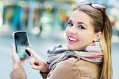 picture of overcoats  - Woman using mobile phone  - JPG