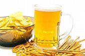 Pretzels, Breadsticks, Chips And Beer Closeup