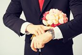 close up of young man giving bouquet of flowers