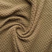 Knitted beige cloth material fragment