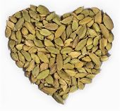 foto of cardamom  - Cardamom seeds in the form of heart on a white background - JPG