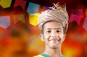 stock photo of party hats  - Boy wearing caipira clothes for the Brazilian Junina Party  - JPG