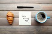 pic of monday  - Cup of coffee with fresh croissant and Happy Monday massage on wooden background - JPG
