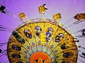 image of amusement park rides  - Instagram filtered image of an amusement park swing ride - JPG