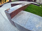 stock photo of parallelepiped  - Stone marble borders on a city street close up with wide angle distortion view - JPG