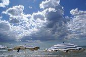 Beach & Umbrellas Waiting For The Storm