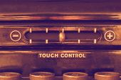 stock photo of levers  - Close up of vintage typewriter front panel with touch control lever and the tops of four keys in muted warm purple and gold hues - JPG