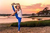 image of tantric  - Female Yoga Model Standing Split on Beach - JPG