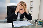 pic of employee month  - Portrait Of Stressed Businesswoman Sitting At Desk With Gantt Progress Chart - JPG