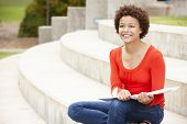 stock photo of 15 year old  - Mixed race student working outdoors - JPG