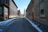 picture of illinois  - An alley between large buildings in Joliet - JPG