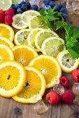 image of infusion  - Sliced fresh organic fruits prepared to make infused water - JPG