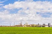 pic of silos  - Agricultural landscape with farm and silos and a sky with clouds - JPG