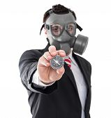 picture of gas mask  - Business man with gas mask holding compass - JPG