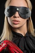 image of sadist  - Portrait of young beautiful woman in studded blindfold - JPG