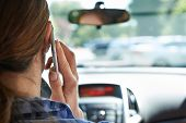 foto of people talking phone  - Woman In Car Talking On Mobile Phone Whilst Driving - JPG