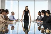 Group Of Business People Having Board Meeting Around Glass Table poster