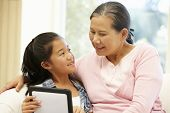 pic of granddaughter  - Senior Asian woman and granddaughter with tablet - JPG