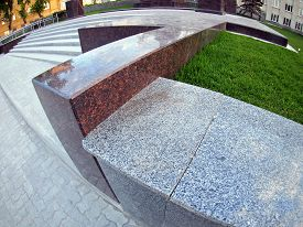 picture of parallelepiped  - Stone marble borders on a city street close up with wide angle distortion view - JPG
