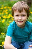 The boy in dandelions field.