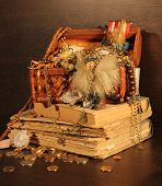 A toy viking with wooden treasure chest standing on books