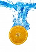 Orange dropped in a water
