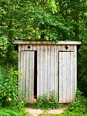 stock photo of outhouses  - Old wooden outhouse in the forest - JPG