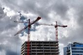 Steel crane at building site on the blue sky