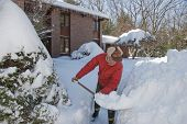 image of snow shovel  - Man shoveling snow off his walkway after a storm - JPG