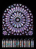 stained glass window in Notre dame cathedral, Paris, France