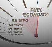 stock photo of fuel efficiency  - The words Fuel Economy on a vehicle speedometer with a red needle racing past numbers 10 - JPG